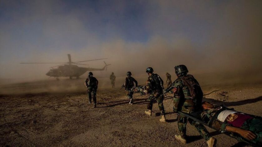 Afghan army commandos participate in a casualty evacuation training exercise near Camp Shorab, in Helmand province, in 2017.