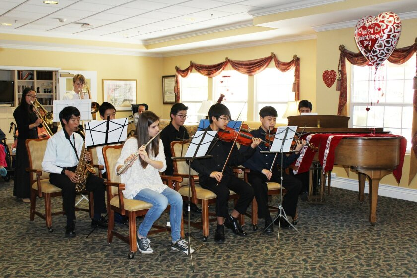 Members perform for seniors recently at Emeritus at Carmel Valley.