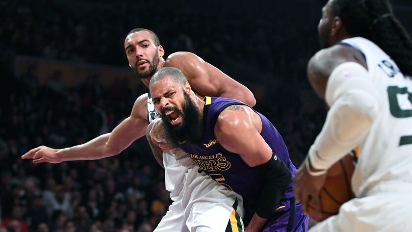 The Lakers' Tyson Chandler and Jazz's Rudy Gobert battle for position as Jae Crowder drives to the basket.