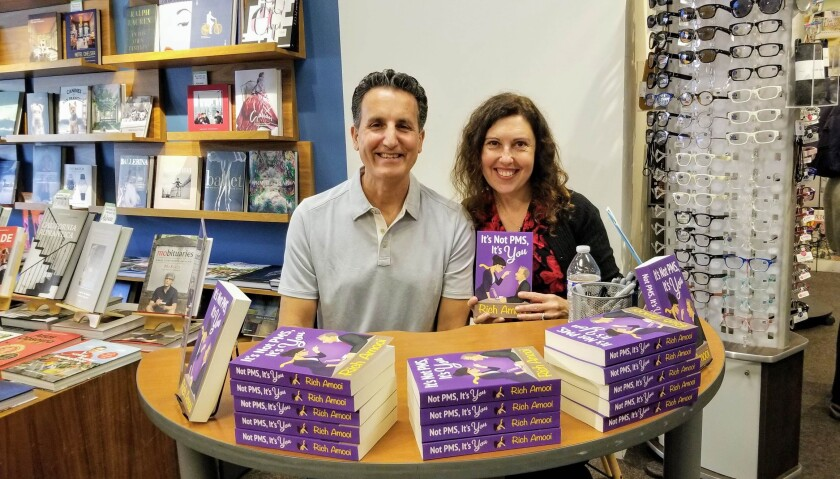 Author Rich Amooi and his wife, Silvi Martin, at a book signing at Warwick's in La Jolla.