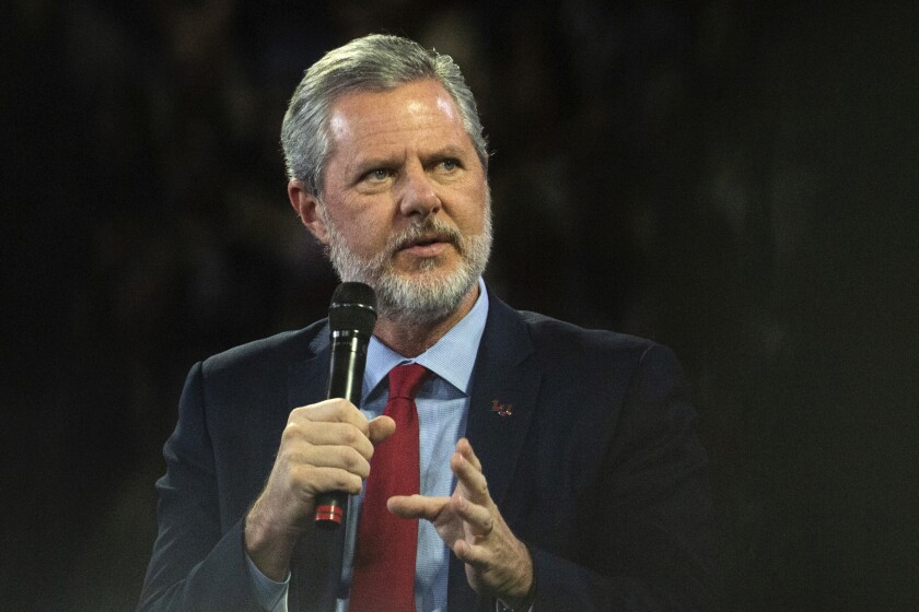 """FILE - In this, Nov. 13 2019, file photo, Liberty University President Jerry Falwell Jr. talks to Donald Trump Jr. about his new book """"Triggered"""" during convocation at Liberty University in Lynchburg, Va. Falwell is asking a court in Virginia to dismiss a lawsuit Liberty University filed over his headline-grabbing departure last year as leader of the evangelical school his father founded. (Emily Elconin/The News & Advance via AP, File)"""