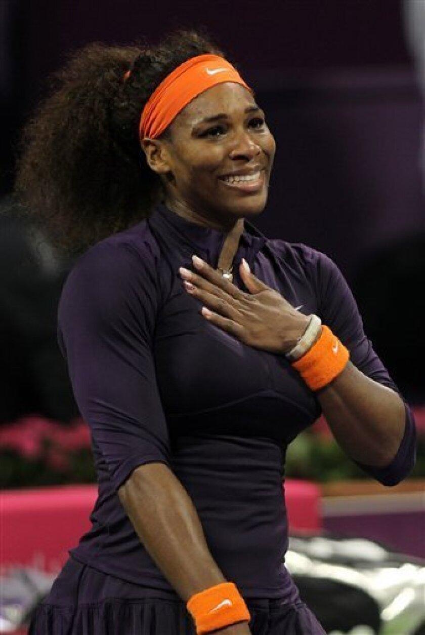 Serena Williams of the U.S. reacts after winning against Czech Republic's Petra Kvitova in their WTA Qatar Ladies Open tennis quarterfinal match in Doha, Qatar, Friday, Feb. 15, 2013. (AP Photo/Osama Faisal)