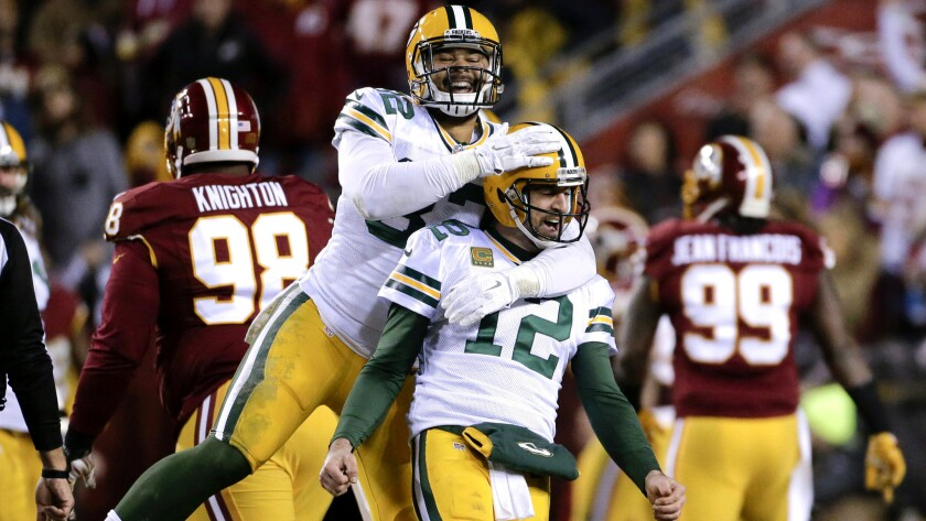 Packers tight end Richard Rodgers (82) celebrates with quarterback Aaron Rodgers (12) after wide receiver Davante Adams caught a touchdown pass against the Redskins on Sunday evening.