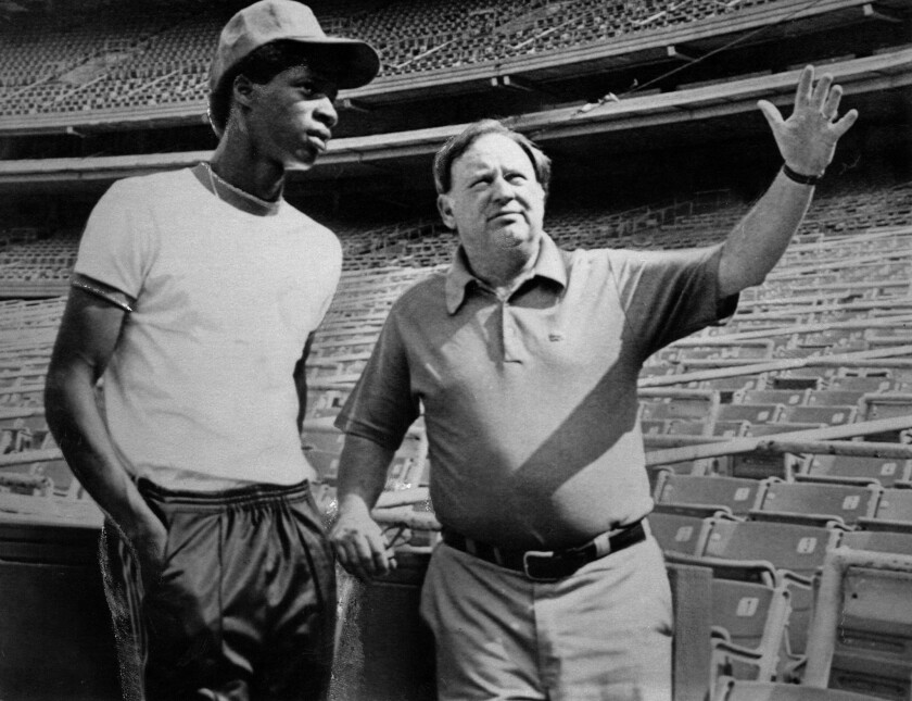 Darryl Strawberry, left, at age 18, being shown Shea Stadium by the late Mets general manager Frank Cashen.