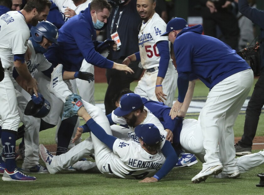 The Dodgers celebrate after clinching the World Series championship with a 3-1 win over the Tampa Bay Rays on Tuesday.
