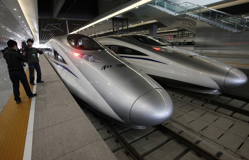 Chinese bullet train leader charged with corruption