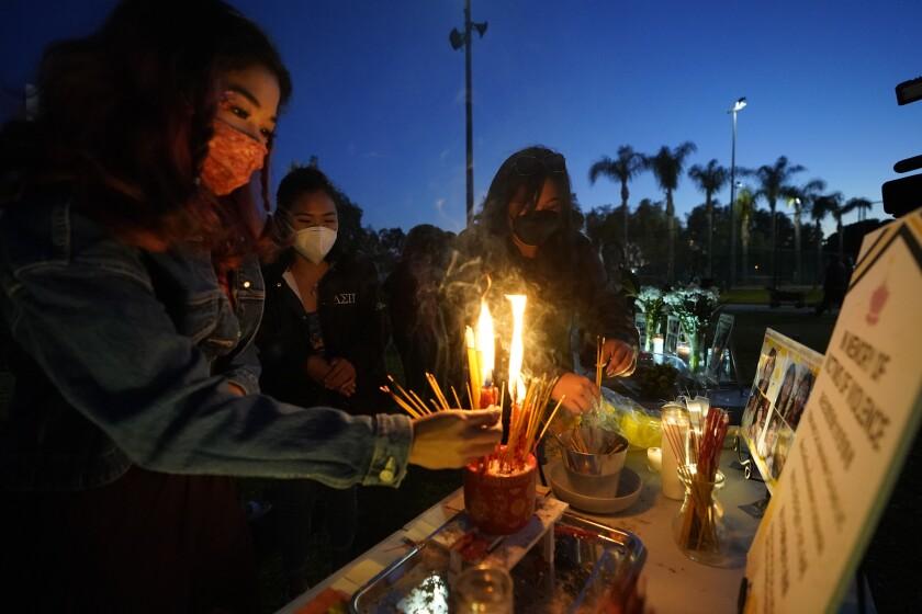 Women at a candlelight vigil