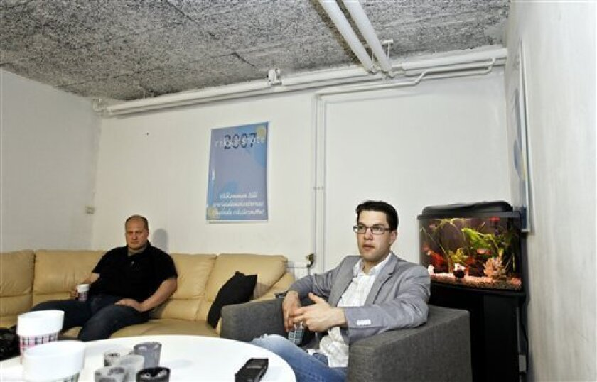 "In this photo taken May 24, 2010, Sweden Democrats party leader Jimmie Akesson speaks during an interview in a basement in Stockholm, Sweden. Akesson said ""In Sweden, if you voice criticism against the immigration policy, you are viewed as a racist or xenophobe."" The man at left is unidentified. (AP Photo/Niklas Larsson)"