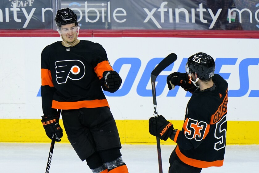 Philadelphia Flyers' Robert Hagg, left, and Shayne Gostisbehere celebrate after Hagg's goal during the third period of an NHL hockey game against the Pittsburgh Penguins, Monday, May 3, 2021, in Philadelphia. (AP Photo/Matt Slocum)