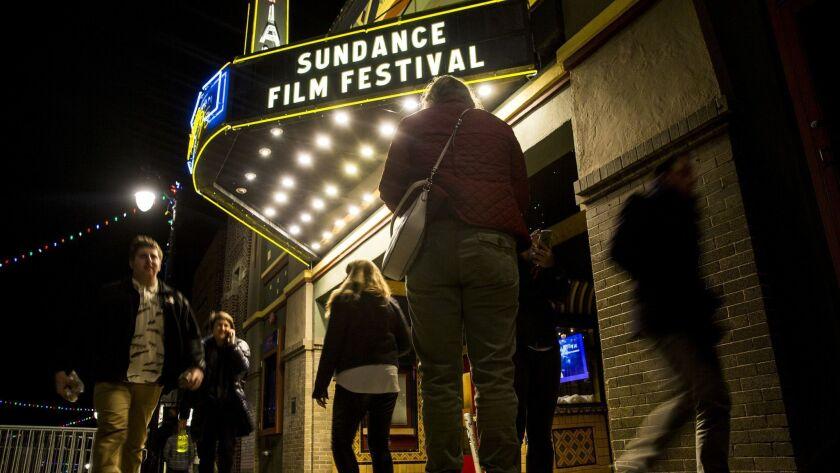 PARK CITY, CA - JANUARY 17: People walk past the Egyptian Theatre, a landmark venue showing films du
