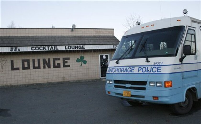 Police cars sit outside J.J.'s Lounge following a shooting in Anchorage, Alaska, Monday, Oct. 10, 2011. Police said two people were killed and two others were wounded during a shooting at the bar in east Anchorage. (AP Photo/Mark Thiessen)