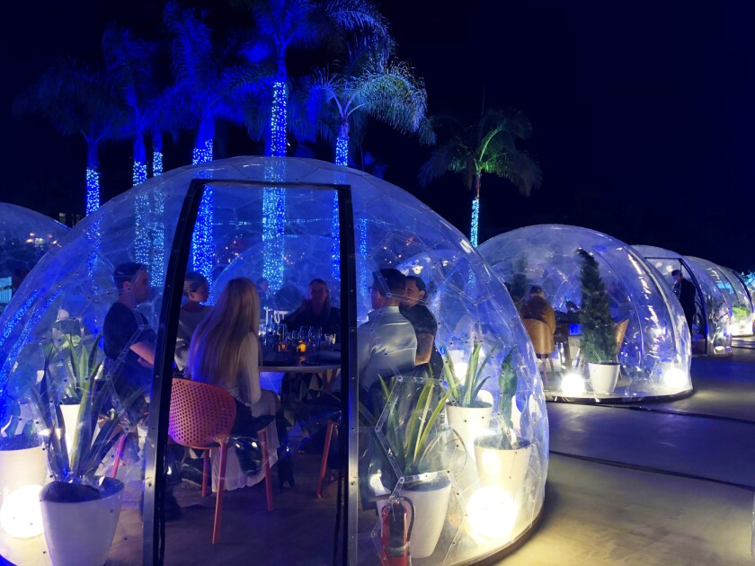 Up to six diners can be seated at tables inside 36 plastic domes for the Dinner With a View event at Liberty Station through March 8.