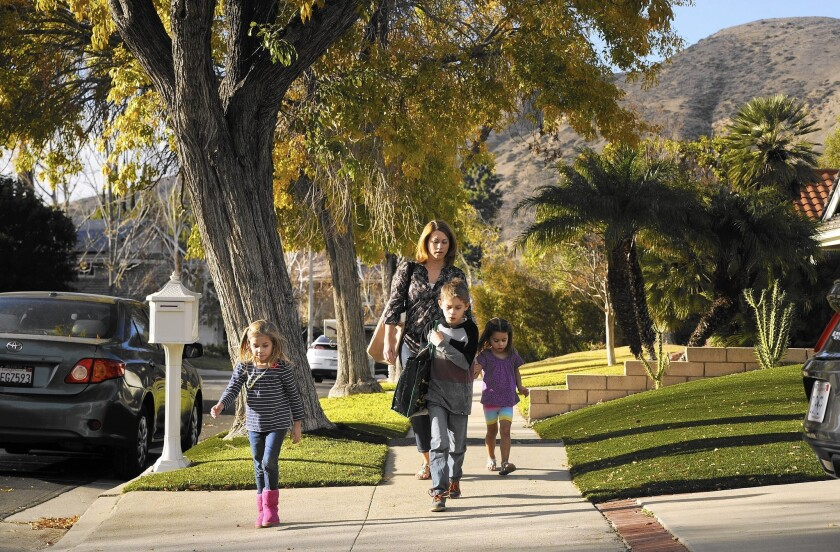 Porter Ranch resident Dee Ann Abernathy walks her children home from school in December. Abernathy said her 6-year-old daughter Nalalie, left, had experienced headaches and other health problems since the Aliso Canyon gas leak began in October.