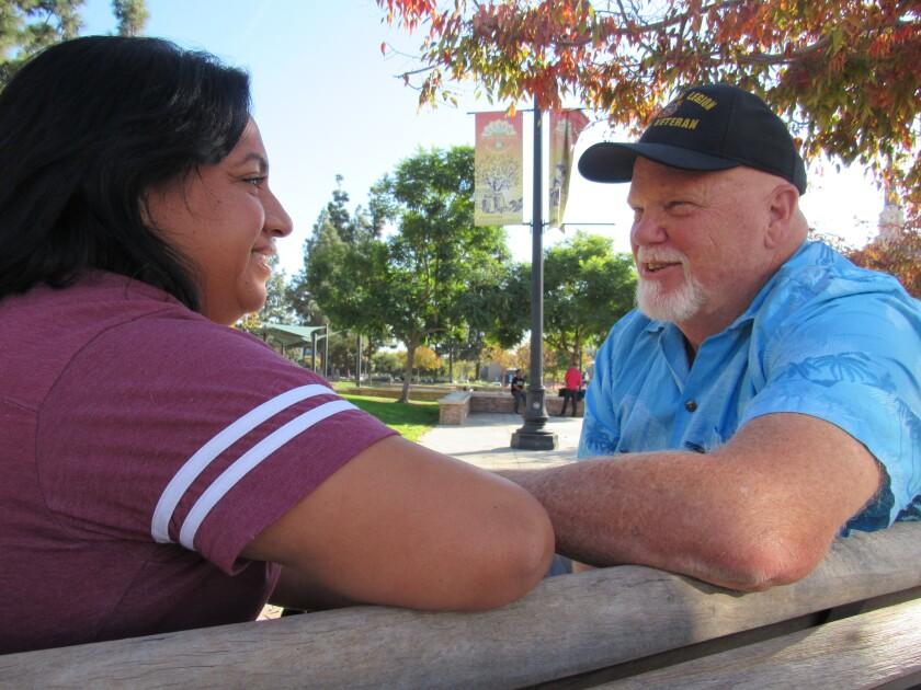 George Glover, Veteran of the Year in El Cajon for 2019, talks with his wife, Claudia, at Prescott Promenade in El Cajon