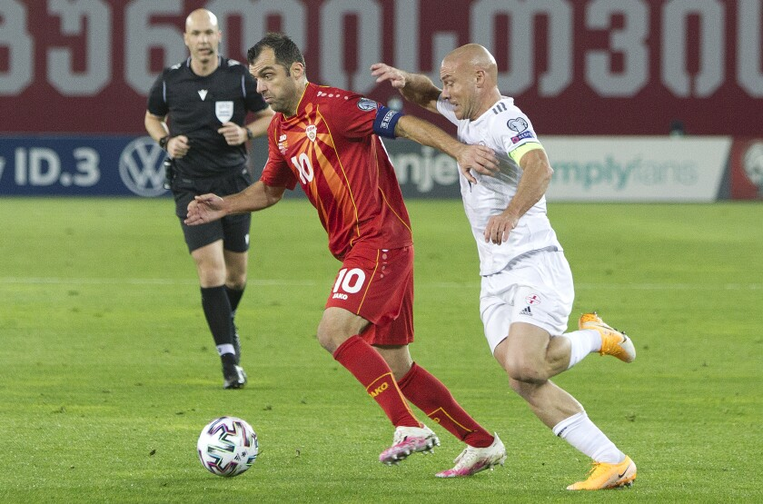 FILE - In this Thursday, Nov. 12, 2020 filer, North Macedonia's Goran Pandev, left, and Georgia's Jaba Kankava challenge for the ball during the Euro 2020 Qualification soccer match between Georgia and North Macedonia at Boris Paichadze Erovnuli stadium in Tbilisi, Georgia. (AP Photo/Shakh Aivazov, File)
