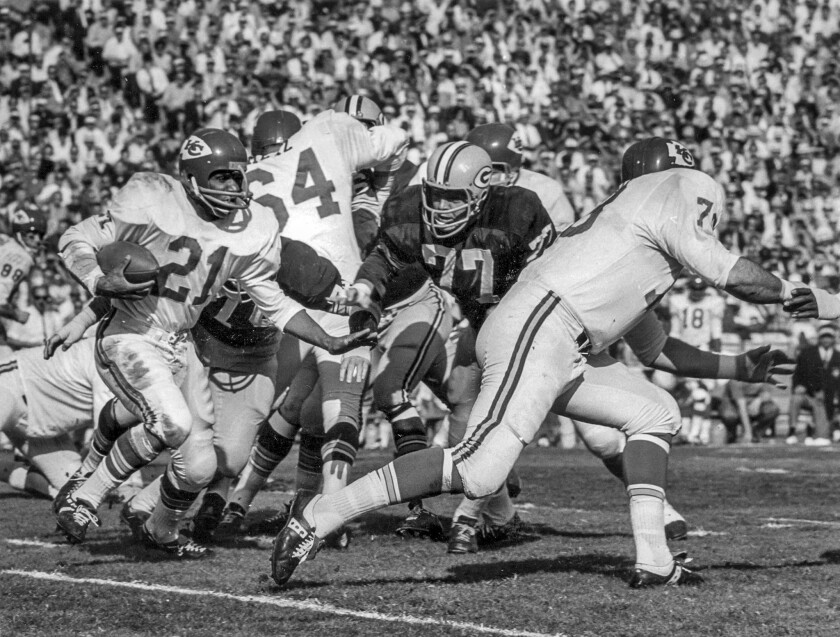 Jan. 15, 1967: Kansas City Chiefs' Mike Garrett running against Green Bay Packers in first Super Bowl. Garrett, the former USC star, was held to 17 yards rushing in the game.