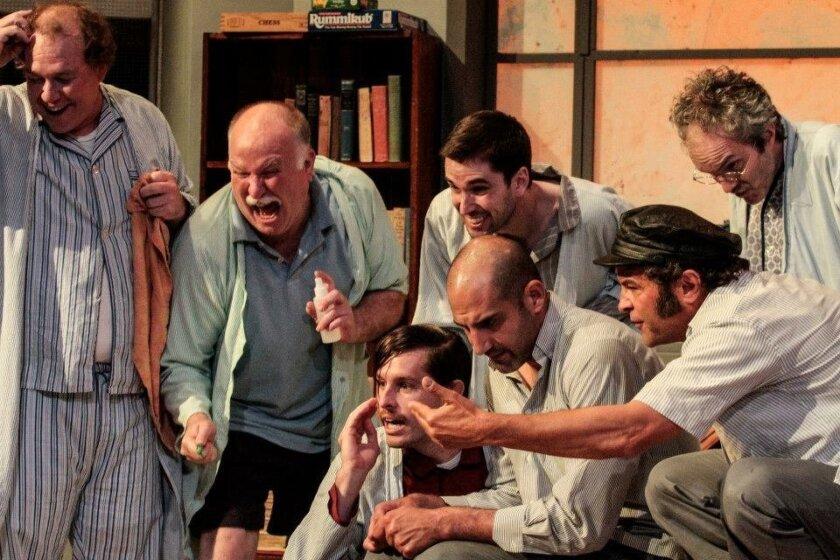"""Max Macke, Tim West, Justin Lang, bottom, Brian Abraham, Kyle Lucy, Jeffrey Jones and Eddie Yaroch in New Village Arts Theatre's """"One Flew Over the Cuckoo's Nest."""" CREDIT: Daren Scott"""