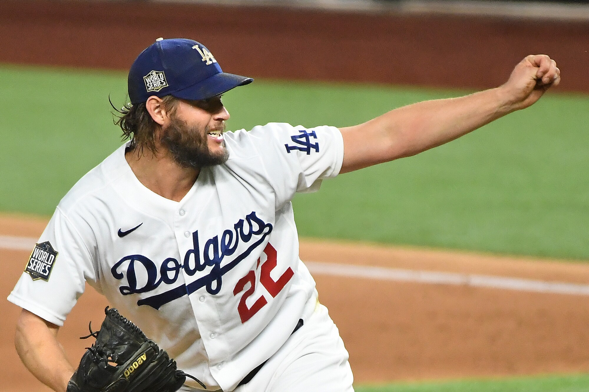 Dodgers starting pitcher Clayton Kershaw delivers during the third inning of an 8-3 win over the Rays.