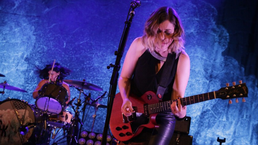 Janet Weiss, left, and Corin Tucker of Sleater-Kinney perform Thursday night at the Palladium in Hollywood.
