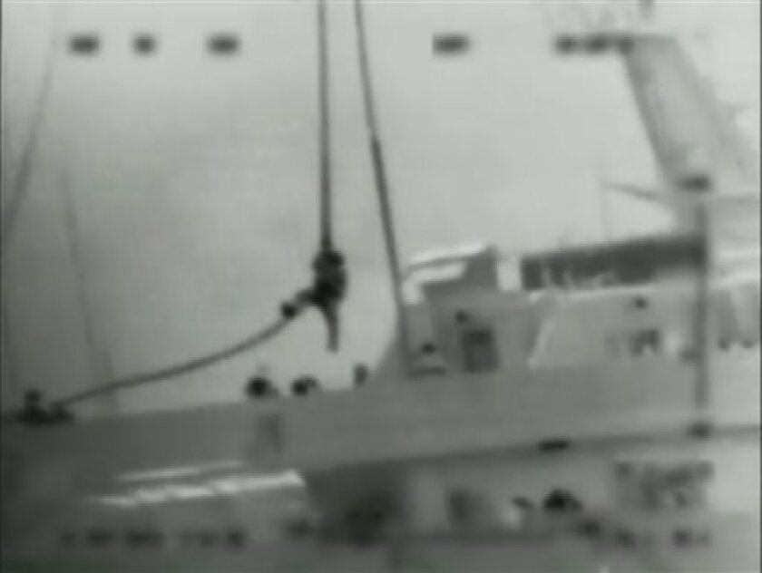 FILE - This file photo made from video provided by the Israeli Defense Force on May 31, 2010 shows what the IDF says is one of several commandos being dropped onto the Mavi Marmara ship by helicopter in the Mediterranean Sea. An Israeli official says a long-awaited U.N. report on bloodshed aboard a Gaza-bound protest flotilla last year shows Israel's actions did not violate international law. The official spoke on condition of anonymity because the report has yet to be officially released. He said publication would likely be later Friday, Sept. 2, 2011. (AP Photo/Israel Defense Force, File) AP HAS NO WAY OF INDEPENDENTLY VERIFYING THE AUTHENTICITY OF THE VIDEO PROVIDED BY THE ISRAELI DEFENCE FORCE
