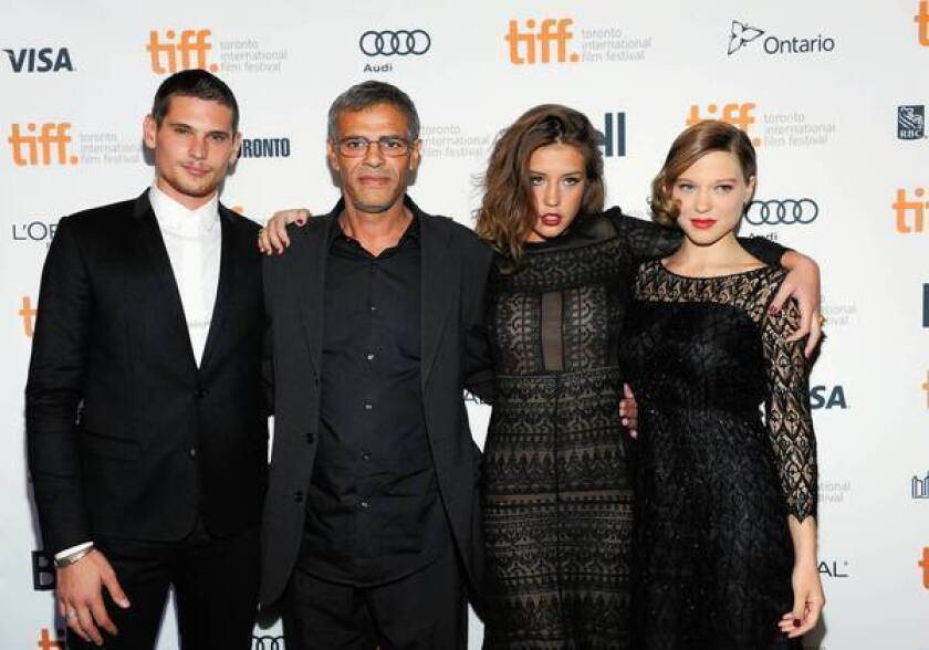 "Jeremie Laheurte, left, director Abdellatif Kechiche, Adele Exarchopoulos and Lea Seydoux attend the ""Blue Is the Warmest Color"" premiere at the Toronto International Film Festival."