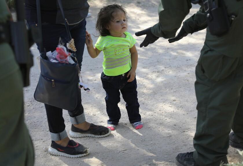 U.S. Border Patrol agents take Central American asylum seekers into custody on June 12, 2018 near McAllen, Texas.