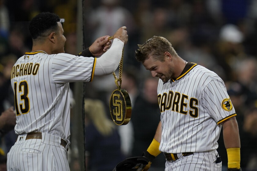 """Brian O'Grady is presented with the Padres' """"Swag Chain"""" by Manny Machado."""