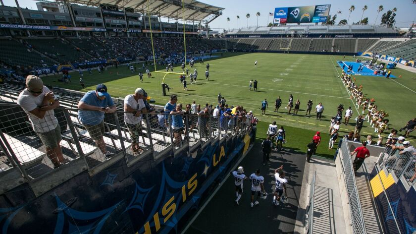 Chargers players enter the field to participate in a joint practice with the Rams at StubHub Center.