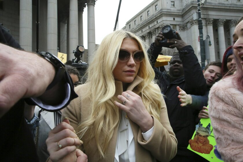 Pop star Kesha leaves Supreme court in New York, Friday, Feb. 19, 2016. Kesha is fighting to wrest her career away from a hitmaker she says drugged, sexually abused and psychologically tormented her _ and still has exclusive rights to make records with her. Producer Dr. Luke says the singer is slin