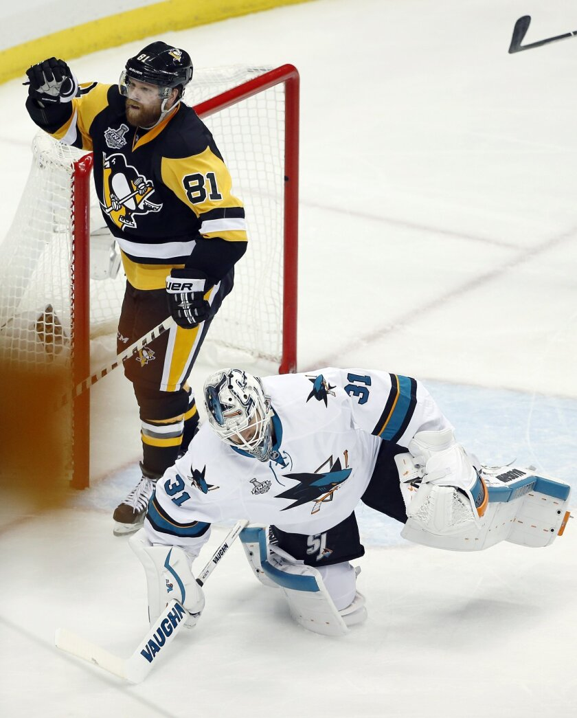 Pittsburgh Penguins' Phil Kessel (81) celebrates his goal behind San Jose Sharks goalie Martin Jones (31) during the second period in Game 2 of the NHL hockey Stanley Cup Finals on Wednesday, June 1, 2016, in Pittsburgh. (AP Photo/Gene J. Puskar)