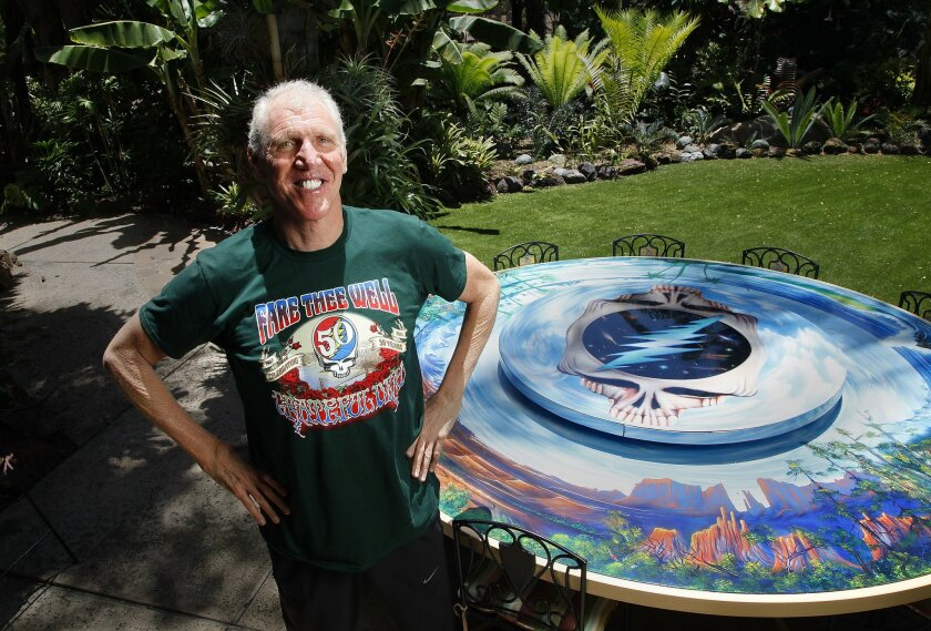 Professional basketball legend Bill Walton, who has seen more concerts by The Grateful Dead than almost anyone, will play a major role at the Dead's upcoming 50th anniversary farewell tour heading to the Bay are and Chicago this summer. Here he poses by a Grateful Dead-inspired table in his Hillcrest backyard.