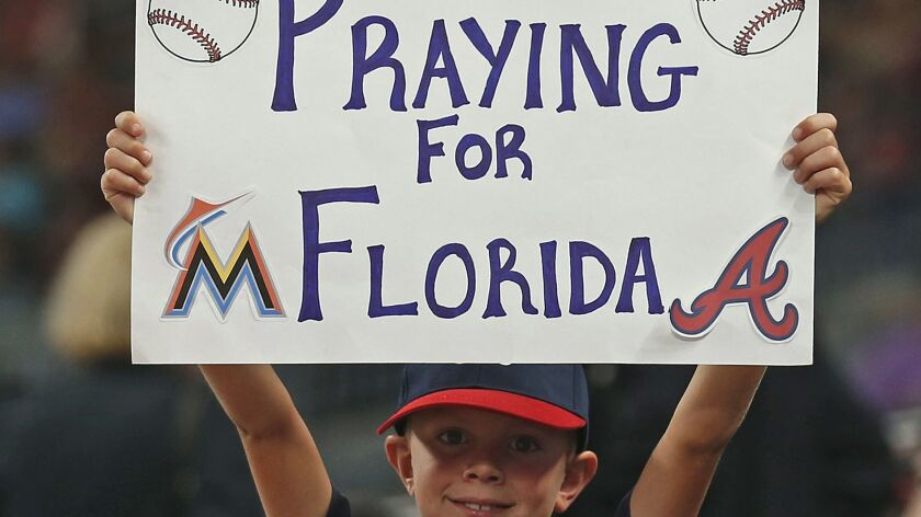 This young fan at the Braves-Marlins game Thursday night had the right idea. The person in charge of the playlist on the stadium sound system did not.