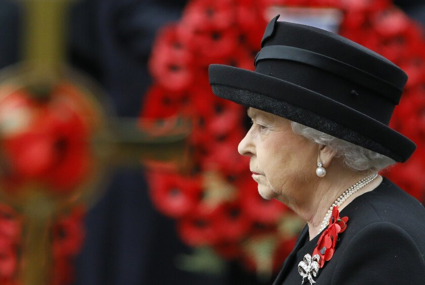 Britain's Queen Elizabeth II attends the Remembrance Sunday service at the Cenotaph in London, Sunday, Nov. 8, 2015. Remembrance Sunday is held each year to commemorate service men and women who fought in past military conflicts. (AP Photo/Kirsty Wigglesworth)