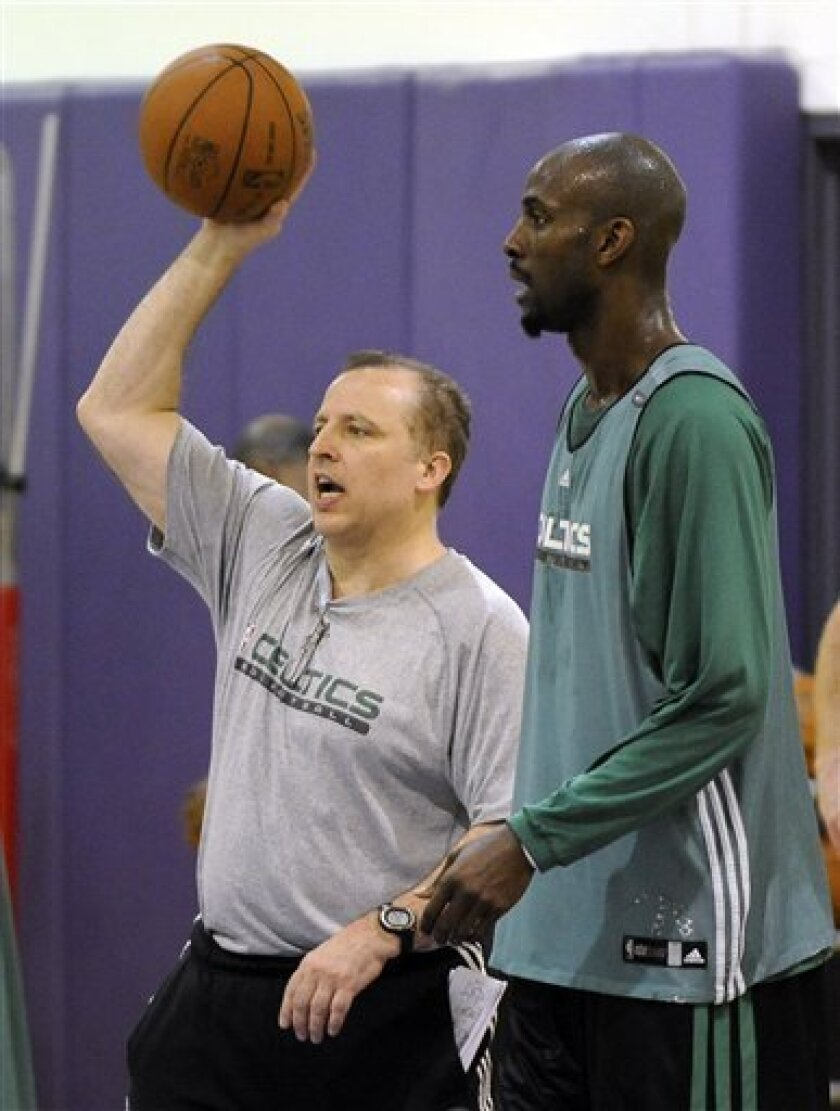Boston Celtics assistant coach Tom Thibodeau, left, gives instructions as forward Kevin Garnett looks on during practice, Saturday, June 5, 2010, in El Segundo, Calif. for the NBA basketball finals. (AP Photo/Mark J. Terrill)