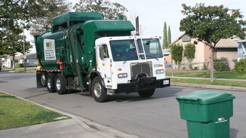 """Green"" green waste truck and cart from Waste Management uses CNG."
