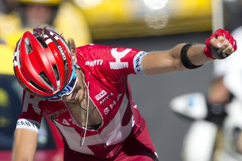 Russia's Ilnur Zakarin celebrates as he crosses the finish line to win during the seventeenth stage of the Tour de France cycling race over 184.5 kilometers (114.3 miles) with start in Bern and finish in Finhaut-Emosson, Switzerland, Wednesday, July 20, 2016. (AP Photo/Peter Dejong)