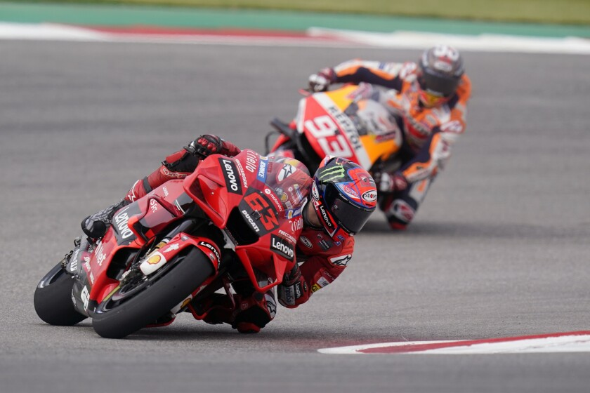 Francesco Bagnaia (63), of Italy, and Marc Marquez (93), of Spain, steer through a turn during an open practice session for the MotoGP Grand Prix of the Americas race at the Circuit of the Americas, Saturday, Oct. 2, 2021, in Austin, Texas. (AP Photo/Eric Gay)