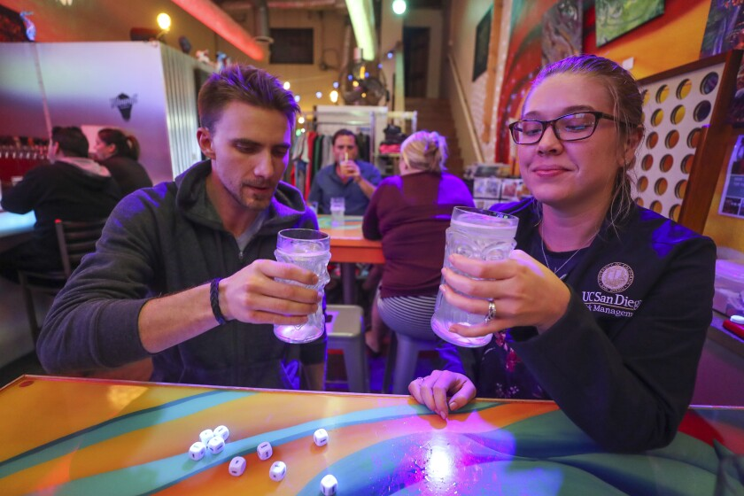 Robert and Erin Davis both try a glass of Ziely Pineapple Hard Seltzer for the first time at Kilowatt Brewing on Tuesday, November 19, 2019 in San Diego.