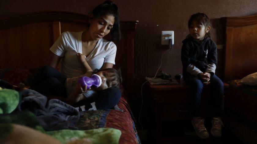 North Hills, CA OCTOBER 24, 2018: Mayla, age 1, lays in her mother Brenda Salgado's, 29, lap in a