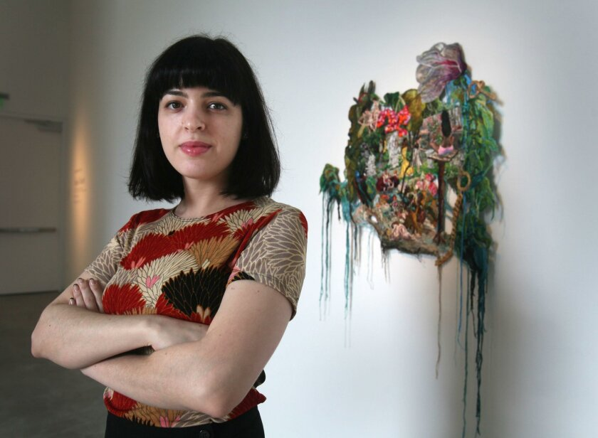 """Sophia Narrett, shown with her piece titled """"Stars Align,"""" is currently in residence at the Lux Art Institute in Encinitas."""