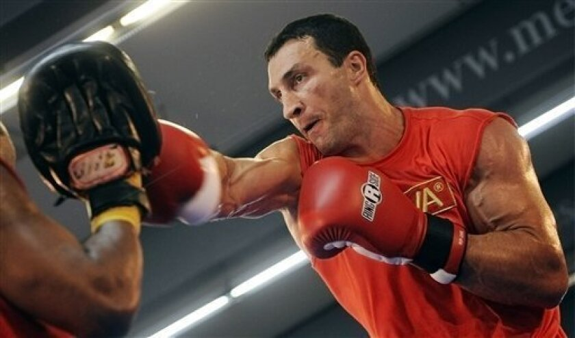 Wladimir Klitschko from Ukraine punches during a training session in Frankfurt, Germany Wednesday Sept. 8, 2010 to prepare for the WBO, IBF and IBO and WBO heavyweight championships title bout against Samuel Peter from Nigeria on Saturday. (AP Photo/dapd/ Thomas Lohnes)