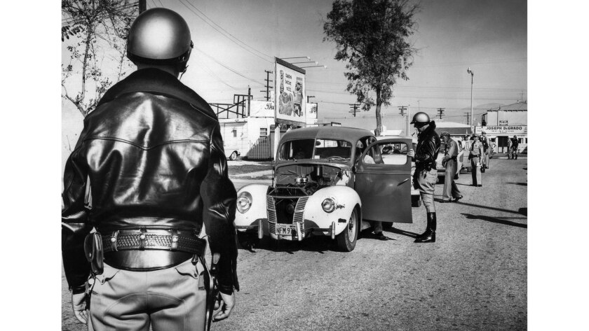 Dec. 20, 1957: California Highway Patrol officers halt cars on Whittier Boulevard during a holiday campaign to keep drunk drivers and defective automobiles off the roads.
