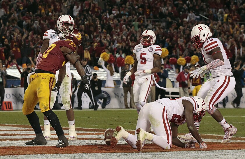USC running back Javorius Allen celebrates after scoring on a two-yard run against Nebraska in the third quarter of the Holiday Bowl.