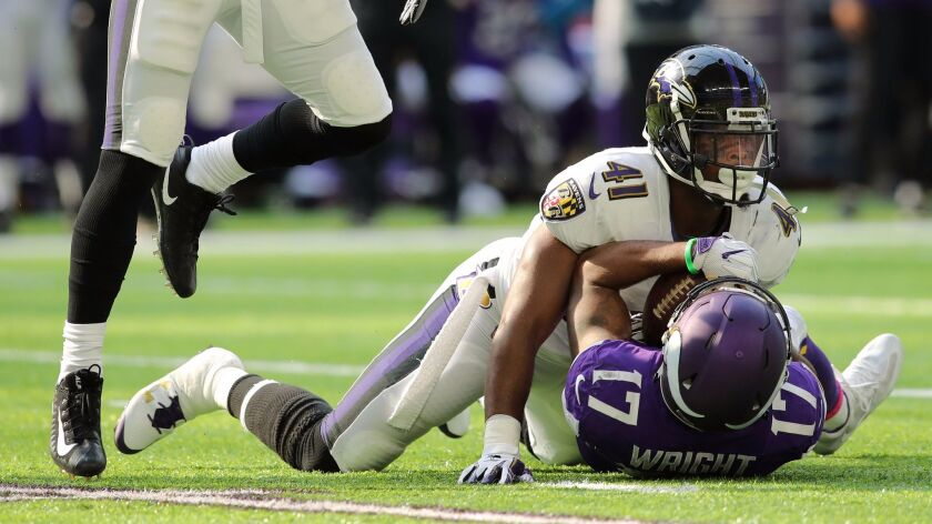 """Jarius Wright of the Minnesota Vikings is tacked by Anthony Levine (41) of the Baltimore Ravens in their Oct. 22 game. Levin has been listed as """"questionable"""" on the injury report the past three weeks and ended up playing almost his usual compliment of snaps."""