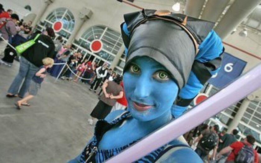 """Kelsey Newman of Hermosa Beach took in the final day of Comic-Con dressed as Alema Rar from """"Star Wars."""" (Howard Lipin / Union-Tribune)"""