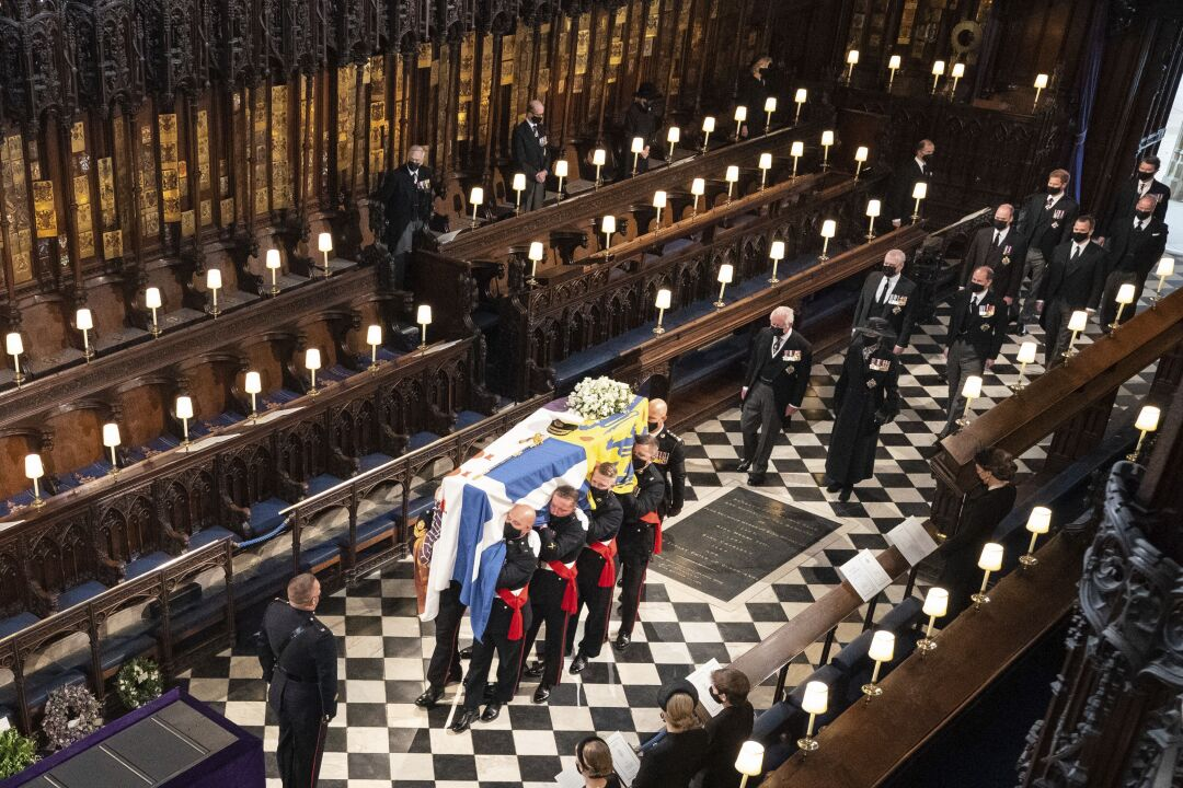 Pallbearers carry the coffin of Prince Philip inside St. George's Chapel.