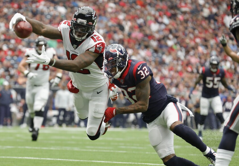 Atlanta Falcons receiver Mohamed Sanu dives for a touchdown while defended by Houston Texans' Lonnie Johnson on Oct. 6.