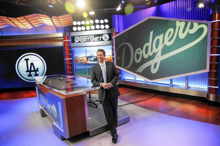 John Hartung will be the main studio anchor for SportsNet LA, a new channel launching as the TV home of the Los Angeles Dodgers. Hartung is shown at Time Warner Cable Sports Networks studio in El Segundo.
