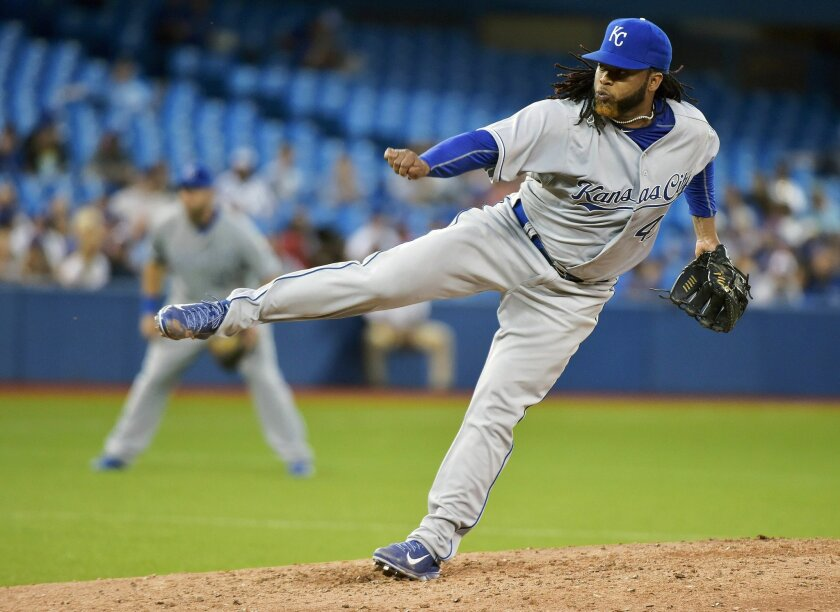 Kansas City Royals starting pitcher Johnny Cueto works against the Toronto Blue Jays during the fifth inning of a baseball game, Friday, July 31, 2015 in Toronto. (Nathan Denette/The Canadian Press via AP) MANDATORY CREDIT
