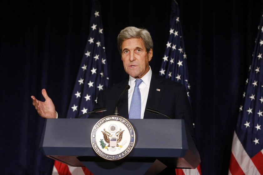 Secretary of State John F. Kerry speaks in New York on Sept. 22. The State Department says the U.S. is suspending bilateral contacts with Russia over Syria.